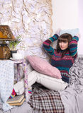Girl winter clothes in a cozy interior Royalty Free Stock Photos