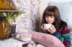 Girl in winter clothes drinking tea Royalty Free Stock Image