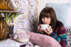 Girl in winter clothes drinking tea Stock Photography