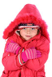 Girl in winter clothes embracing herself isolated Royalty Free Stock Photos