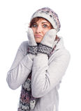 Girl in winter clothes frozen Stock Photo