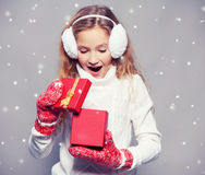 Girl in winter clothes with gift Royalty Free Stock Image