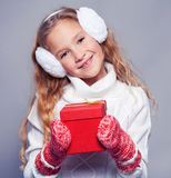 Girl in winter clothes with gift. Happy girl Stock Photography