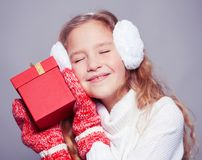 Girl in winter clothes with gift. Happy girl Royalty Free Stock Photos