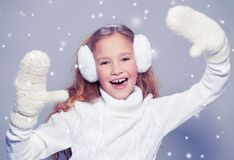 Girl in winter clothes with gift. Happy girl Royalty Free Stock Images