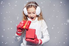 Girl in winter clothes with gift. Happy girl Royalty Free Stock Photography