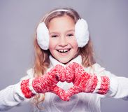 Girl in winter clothes with gift. Happy girl Royalty Free Stock Photo