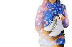 Girl in winter clothes and hat holding a white figure skates ove Stock Photos