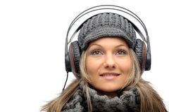Girl with winter clothes and headphones Stock Photo