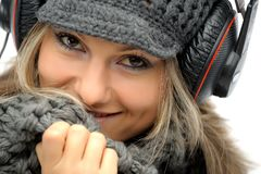 Girl with winter clothes and headphones Royalty Free Stock Images