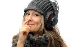 Girl with winter clothes and headphones Royalty Free Stock Photos