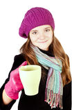 Girl in winter clothes holding cup of cure Royalty Free Stock Images
