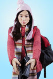 Girl in winter clothes holding empty wallet Stock Photos