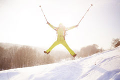 Girl in winter clothes jumping up. Royalty Free Stock Photography