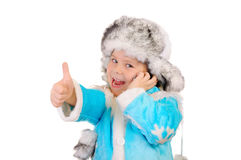 Girl in winter clothes with phone. Sign OK stock image