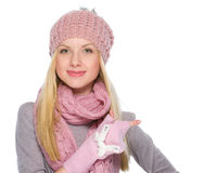Girl in winter clothes pointing on copy space Royalty Free Stock Images