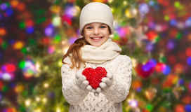 Girl in winter clothes with small red heart Stock Photography