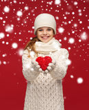 Girl in winter clothes with small red heart Royalty Free Stock Photo