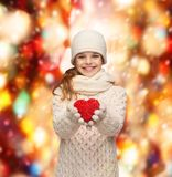 Girl in winter clothes with small red heart Royalty Free Stock Images
