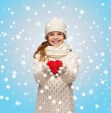 Girl in winter clothes with small red heart Stock Photos