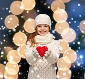 Girl in winter clothes with small red heart Royalty Free Stock Photos