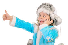 Girl in winter clothes speaks by phone Royalty Free Stock Photos