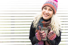 Girl in Winter Clothes and Warming Drink Stock Photography