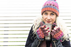 Girl in Winter Clothes and Warming Drink Stock Images