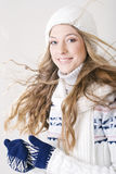 Girl in winter clothing. Studio portrait sweet blond girl in winter clothing Royalty Free Stock Images