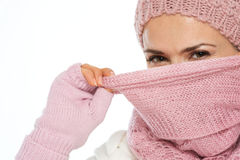 Girl in winter clothing closing face with scarf Stock Photography