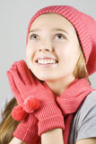 Girl in winter clothing looking up Stock Photography