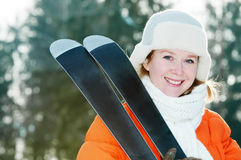 Girl at winter clothing with skis Stock Photo