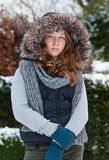 Girl in winter cloths and fur hood. Outdoor portrait of a teenager girl in winter cloths Stock Photo