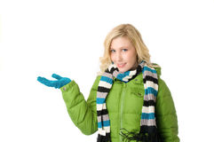 Girl in winter coat. Young girl in winter coat holding hand up Royalty Free Stock Photos