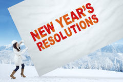 Girl with winter coat and a resolution banner Stock Photography