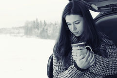 Girl at winter with cup of hot drink Stock Photos