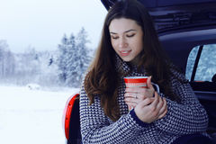 Girl at winter with cup of hot drink Royalty Free Stock Photo
