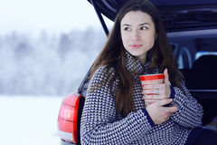 Girl at winter with cup of hot drink Royalty Free Stock Images
