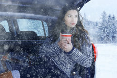 Girl at winter with cup of hot drink Royalty Free Stock Photos