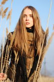 Girl in a winter field Stock Image