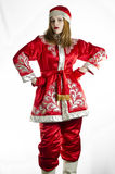 Girl in winter folk costume Stock Image
