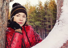 Girl in winter forest. Girl in red jacket against the backdrop of the winter forest Royalty Free Stock Image