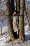 A girl in winter forest Royalty Free Stock Image
