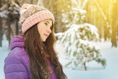 Girl on winter forest background Stock Images