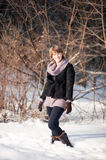 Girl in winter forest Stock Photography