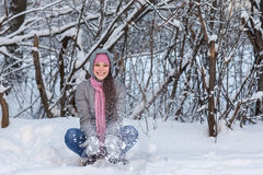 Girl in a winter forest. Stock Photos