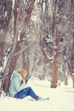 Girl in winter forest Stock Image