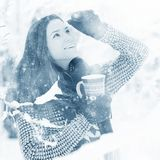 Girl at  winter forest with cup of hot drink Royalty Free Stock Images