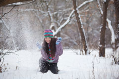 Girl in winter forest fun Royalty Free Stock Photos