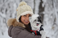 Girl in the winter forest with her dog Royalty Free Stock Photo